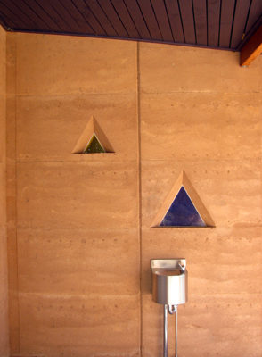 Tailor made set ins add a unique touch to the rammed earth walls
