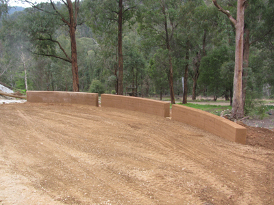 Completed curved rammed earth feature wall after using Flexiform(TM)