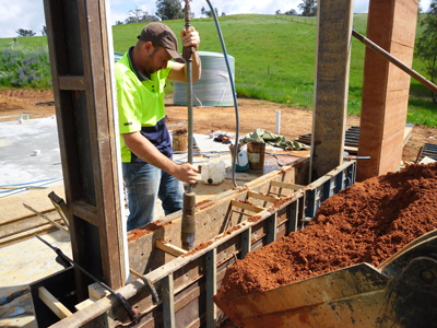 Riverina Rammed Earth Construction owner Anthony Wright getting his hands dirty