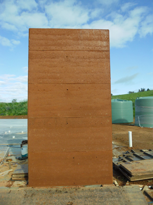 A finished rammed earth wall section