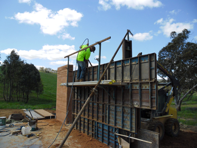 Repeating the rammed earth process lift by lift