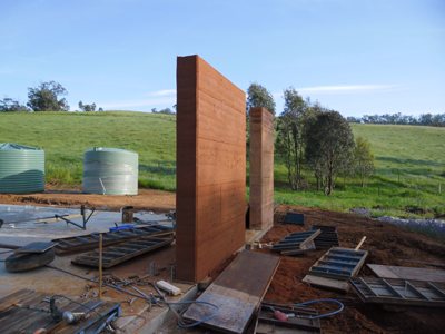 Another completed rammed earth wall section