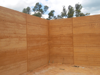 A finished rammed earth corner section