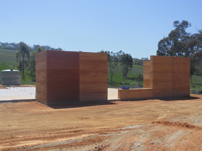 As sections of completed rammed earth cure they dry to a lighter shade