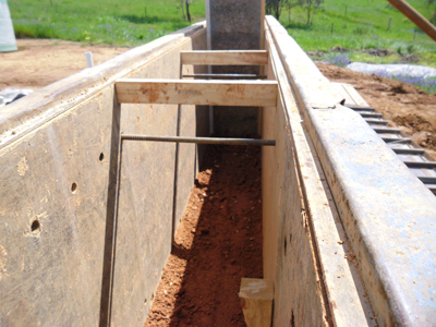 After a layer of mix has been compacted repeat the process until formwork lift is full