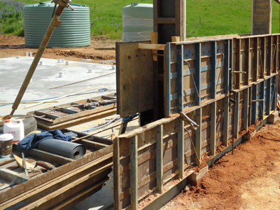Add new lift of rammed earth formwork after completing lift one
