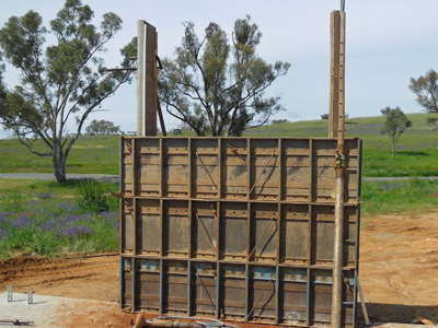 Continue building up with lifts of formwork