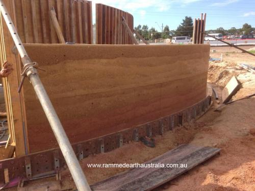 Curved multi coloured Rammed Earth in Sydney